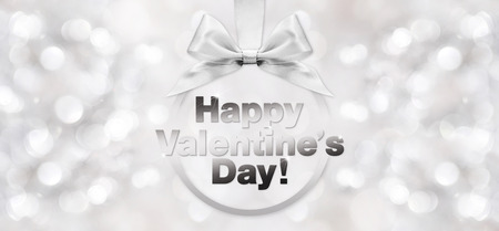 silver ribbon: happy valentines day text with shiny silver ribbon bow on blurred background Stock Photo