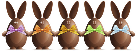 Chocolate Easter bunnies with ribbons bows in various colors on white background Foto de archivo
