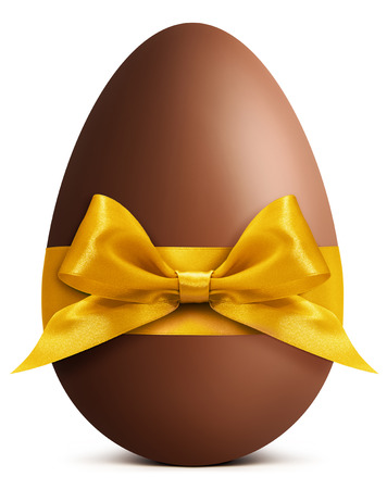 Chocolate Easter Egg with golden ribbon Bow isolated on white background Foto de archivo