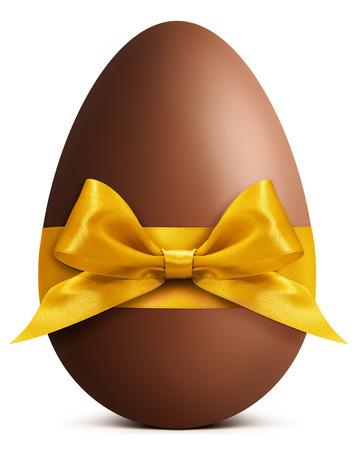 osterei: Schokoladen-Osterei mit goldenen Band Bogen isoliert auf weißem Hintergrund