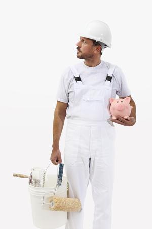コンセプトを節約貯金、白地では、分離された画家男