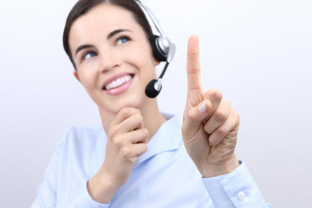 press agent: contact us, customer service operator woman with headset, touch screen