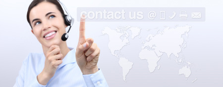 contact information: Customer service operator woman with headset smiling, world map on background, contact us icons Stock Photo