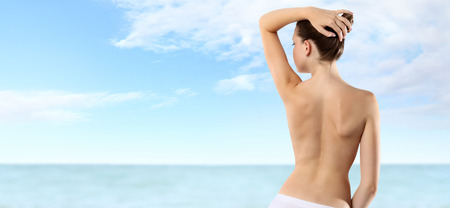back of woman isolated on sky and sea background