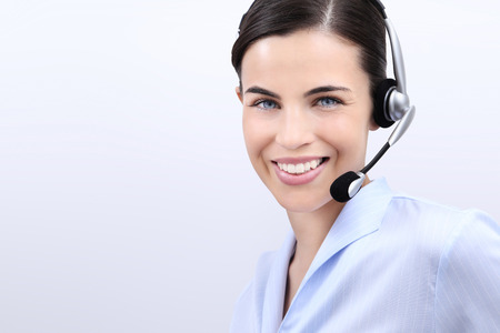 contact centre: contact us, customer service operator woman with headset smiling, isolated on white background