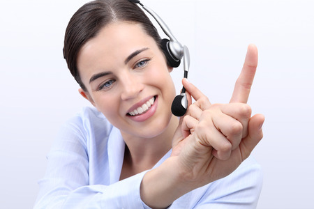 press agent: contact us, customer service operator woman with headset, touch screen with finger