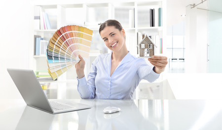 furnish: smiling woman in office Stock Photo