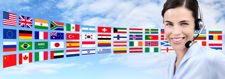 foreign nation: customer service operator woman with headset smiling isolated on international flags  sky background