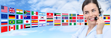 international flags: customer service operator woman with headset smiling isolated on international flags sky background