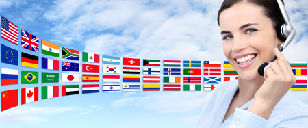 foreign nation: contact us, customer service operator woman with headset smiling on international flags background