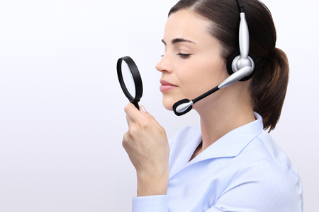 optimized: search concept, woman with magnifying glass and headset