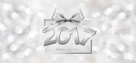 2017 Happy New Year text in blurred silver Background for your Flyers and Greetings Card. Ideal to use for parties invitation, Dinner invitation, Christmas Stock Photo