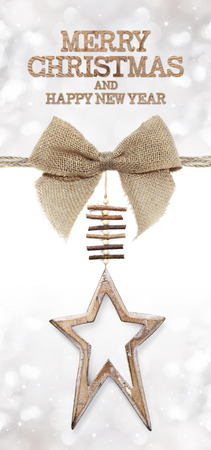 jute: merry christmas and happy new year text with wooden star and jute bow