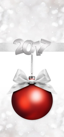 christmas red ball with silver satin ribbon bow on silver blurred background