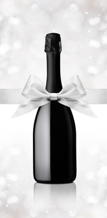 silver ribbon: wine bottle gift with silver ribbon Stock Photo