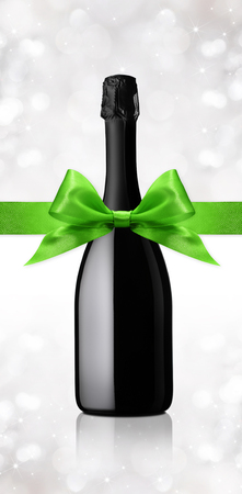 gift ribbon: wine bottle gift with green ribbon Stock Photo