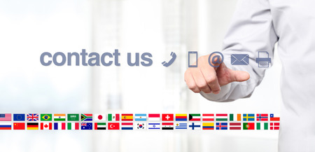 world flag: hand touch screen display with global contact us concept text, flags and icons