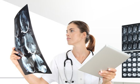 Radiologist woman checking xray. healthcare, medical and radiology concept