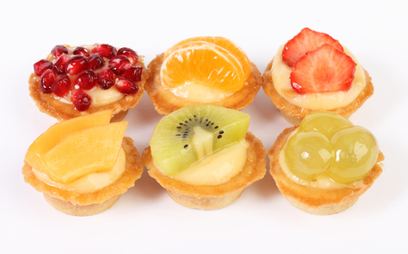 pastries: pastry tartlets with fresh fruit isolated on white