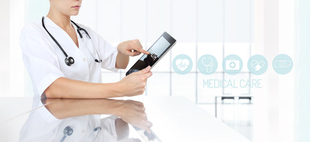 prescription pad: doctor using tablet in medical office and icons, web banner Stock Photo