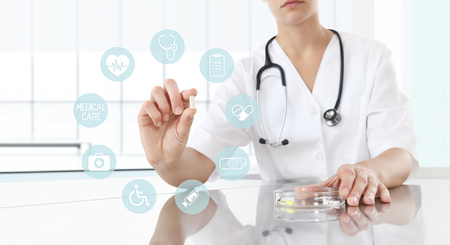 Doctor holding pill medicine close up. Health care and medical icons, medicine concept