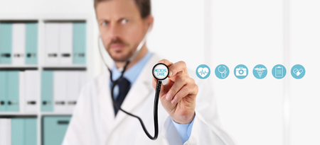 a medical examination: Doctor with a stethoscope in the hands and medical icons on virtual screen