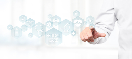 Doctor hand touching medical blue icons on virtual screen