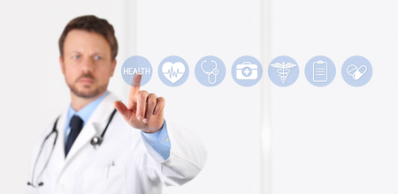 health technology: Doctor hand touching medical blue icons on screen
