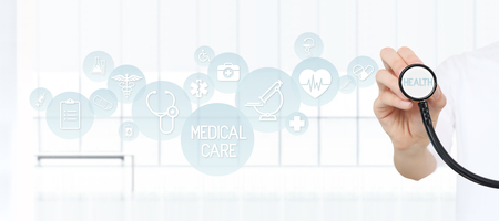 Doctor showing a stethoscope in the hands with medical blue icons