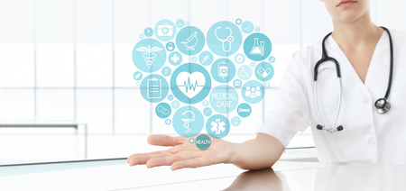 hand doctor with medical blue heart icons Stock Photo