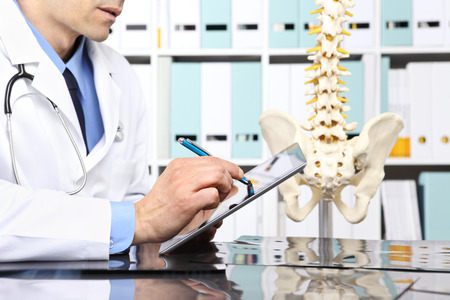 Radiologist doctor with digital tablet checking xray, healthcare, medical and radiology concept.