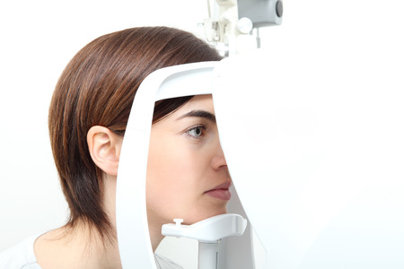 woman doing eyesight measurement with optical slit lamp Stock Photo
