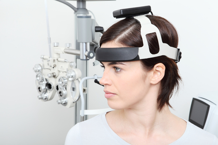 diopter: woman doing eyesight measurement, balance test