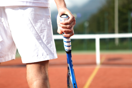 tennis player with racket during a match game, close up