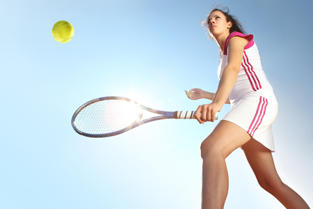 tennis player with racket during a match game isolated on sky
