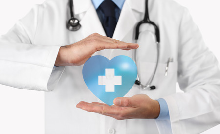 medical health insurance concept, cross and heart symbol.