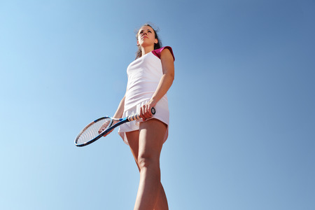 woman tennis player with racket during a match game, isolated.