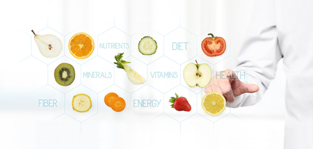 complementary therapies: healthy food concept, Hand of nutritionist doctor pointing fruits.