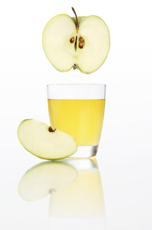 Apple juice in glass isolated on white background. Stock Photo