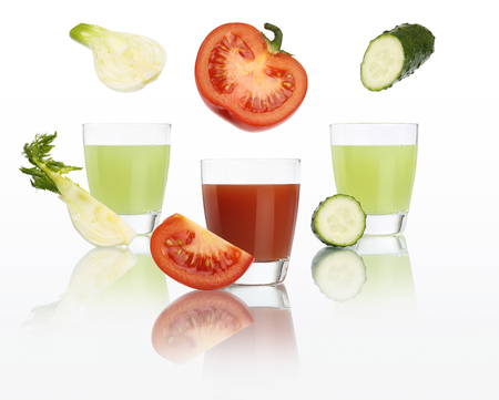 Vegan and diet concept. Tomato, fennel and cucumber juice in glass isolated on white background. Stock Photo