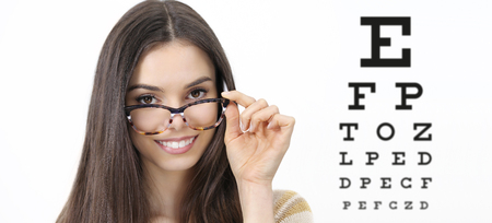 smile female face with spectacles on eyesight test chart background, eye examination ophthalmology concept.