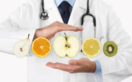 healthy food diet concept, Hands of nutritionist doctor with fruits. Stock Photo