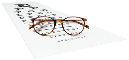 spotted eyeglasses on eyesight test chart isolated on white. eye examination ophthalmology concept. Stock Photo