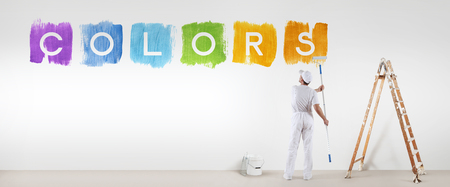 painter man painting colors text isolated on blank white wall background, banner web.