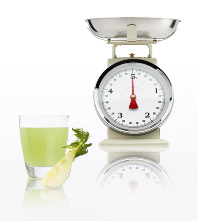 alimentacion balanceada: food scale with fennel juice glass isolated on white background, Balanced diet concept.