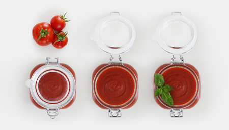 tomato sauce glass jar with tomatoes and basil Isolated on white background.