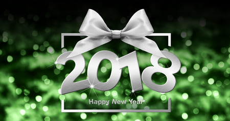 happy new year text in box frame with silver ribbon bow on green christmas blurred lights background. Stock Photo