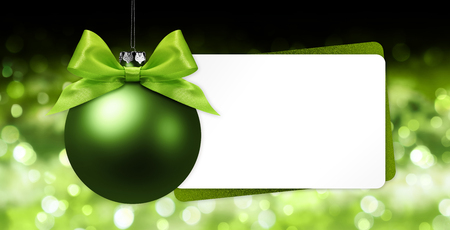 greeting gift card with green christmas ball on blurred lights background white template copy space