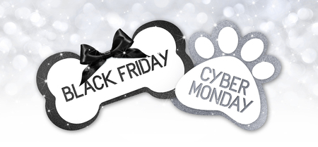 pet shop black friday and cyberg monday sale text write on gift card label with black ribbon bow on silver bright lights background.