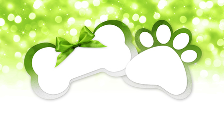 pets store gift card with bone and paw imprint shape green ribbon bow on blurred christmas lights background blank template and copy space.